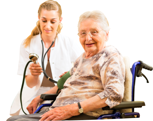 caregiver taking the blood pressure of an old woman